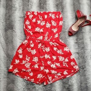 Red rompers with white flowers